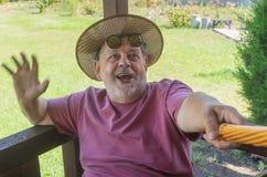 Portrait of bearded senior man making selfie Stock Photos