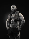 Portrait of bearded strong man with perfect abs, pecs shoulders,biceps, triceps and chest, with towel royalty free stock photos