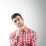 Portrait of bearded thinking young man looking up Stock Photography