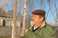 Portrait of a bearded Ukrainian peasant standing under birch tree at fall season Stock Photos