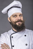Portrait of a bearded young chef with arms folded Stock Images
