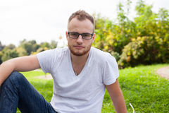 Portrait of bearded young man. Caucasian man smiling happy on su Royalty Free Stock Photos