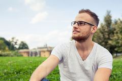 Portrait of bearded young man. Caucasian man smiling happy on su Stock Photos