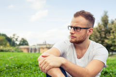 Portrait of bearded young man. Sad caucasian man on sunny summer Stock Photography