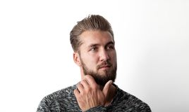 Portrait of a bearded, young and thoughtful man isolated on a white background.  Stock Photography