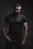 Portrait of a beardy man. Portrait of a bearded man on dark background Stock Image