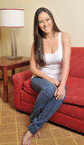 Portrait of beatiful biracial woman in living room Royalty Free Stock Image