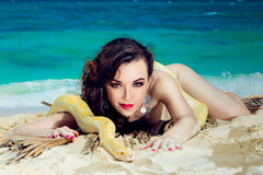 Portrait of the beatiful girl with dangerous snake on the tropic Royalty Free Stock Image