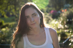 Portrait of beatiful woman in sun lights Royalty Free Stock Images