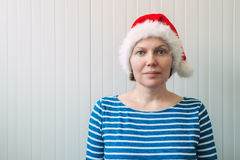 Portrait of beautiful adult caucasian woman with Santa Claus hat Royalty Free Stock Image