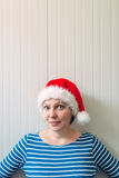 Portrait of beautiful adult caucasian woman with Santa Claus hat Royalty Free Stock Images