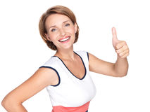 Portrait of a beautiful adult happy woman with thumbs up sign Stock Photos