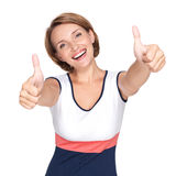 Portrait of a beautiful adult happy woman with thumbs up sign. Isolated on white background Royalty Free Stock Photo