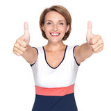 Portrait of a beautiful adult happy woman with thumbs up sign Stock Photography
