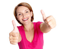 Portrait of a beautiful adult happy woman with thumbs up sign Royalty Free Stock Image
