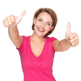 Portrait of a beautiful adult happy woman with thumbs up sign Stock Image