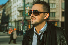 Portrait of beautiful adult male in sunglasses and tie looking a Royalty Free Stock Photo
