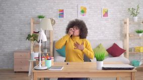 Beautiful african american afro hairstyle sudden asthmatic attack is the use of spray. Portrait Beautiful african american afro hairstyle sudden asthmatic attack stock video