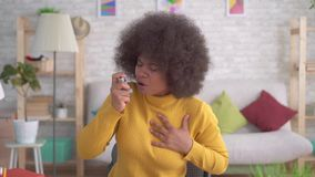 Portrait beautiful african american afro hairstyle sudden asthmatic attack is the use of spray. Portrait beautiful african american afro hairstyle sudden stock footage