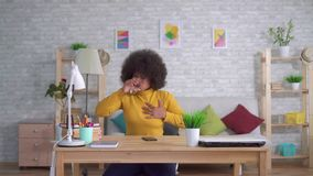 Portrait Beautiful african american woman with an afro hairstyle unexpected attack or heart pain takes a pill stock video