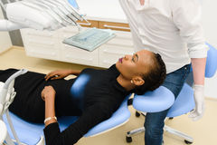 Portrait of beautiful african or black american woman waiting for dental exam Stock Photos