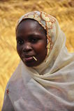 Portrait of beautiful african muslim women. Portrait of  beautiful african women from hausa tribe muslim with veil and traditinal clothing, with tooth stick in Stock Photo
