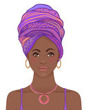 Portrait of beautiful African woman in turban. Tribal style fash Stock Photography