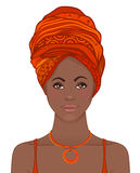 Portrait of beautiful African woman in turban. Tribal style fash Royalty Free Stock Photos