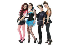 Portrait of beautiful all female rock band over white background Stock Photo