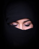 Portrait of beautiful Arab woman wearing black scarf Royalty Free Stock Image