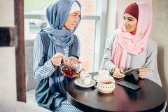 Portrait of young arabic woman working with tablet Stock Photography