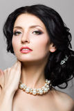 Portrait of beautiful aristocratic woman touching her neck Royalty Free Stock Photos