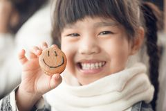 Portrait of beautiful asia Children feel happy eating Bread smiley face.  royalty free stock photography