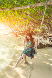 Portrait of beautiful Asia woman wearing long dress on the beach Stock Images