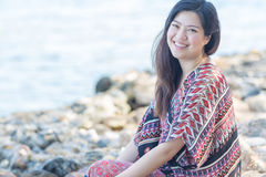 Portrait of beautiful Asia woman wearing long dress on the beach Stock Image