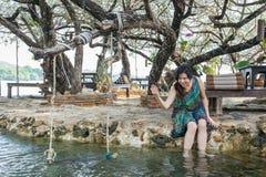 Portrait of beautiful Asia woman wearing long dress on the beach Royalty Free Stock Photo