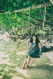 Portrait of beautiful Asia woman wearing long dress on the beach Stock Photo