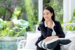 Portrait of beautiful asian businesswoman with smiling and relax sitting on sofa. Stock Photography