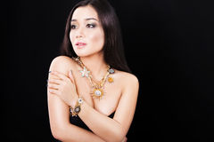 Portrait of a beautiful asian fashion model with. Portrait of a beautiful brunette girl with luxury accessories.Beauty with jewellery. happy fashion model Royalty Free Stock Photo