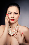Portrait of a beautiful asian  female model wearing pearl beads Royalty Free Stock Photography