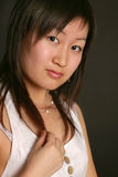 Portrait of beautiful asian girl. On black background stock photography