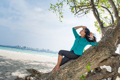 Portrait of a beautiful asian girl on the tree near beach Stock Image