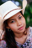 Portrait of a beautiful Asian girl with white hat chilling out during the night on the beach Royalty Free Stock Photo