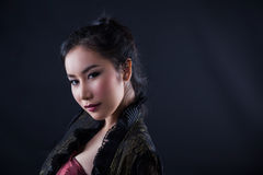 Portrait of beautiful Asian girl. Portrait of beautiful Asian young girl on black background Stock Photos