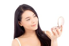 Portrait of beautiful asian woman applying powder puff at cheek makeup of cosmetic. Portrait of beautiful asian woman applying powder puff at cheek makeup of royalty free stock image