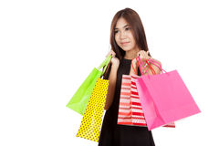 Portrait of beautiful Asian woman with colorful shopping bags Royalty Free Stock Image