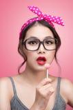 Portrait of beautiful asian woman eating heart shape lollipop, d Royalty Free Stock Images