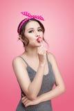 Portrait of beautiful asian woman eating heart shape lollipop, d Royalty Free Stock Image