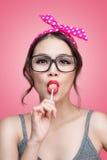 Portrait of beautiful asian woman eating heart shape lollipop, d Royalty Free Stock Photos