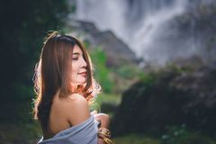 Portrait of beautiful Asian woman enjoy natural outdoor at fores Royalty Free Stock Image